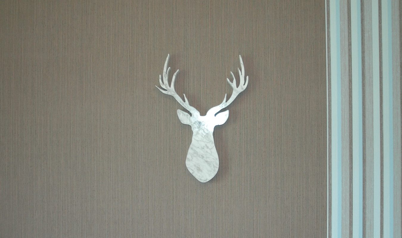 deer-cut-marble-wall